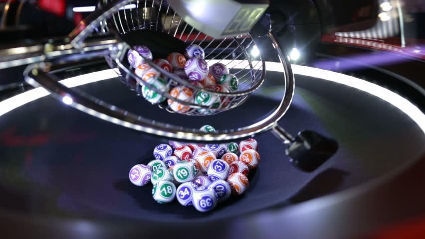 Colourful lottery balls in a lotto machine. Gambling machine and euqipment. | Shutterstock HD Video #23122927
