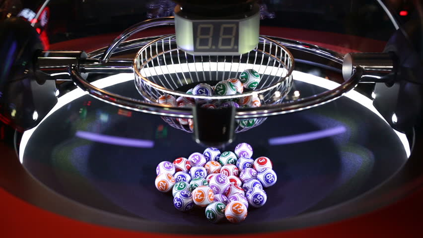 Colourful lottery balls in a sphere in motion. Gambling machine and euqipment. Blurred lottery balls in a lotto machine.
