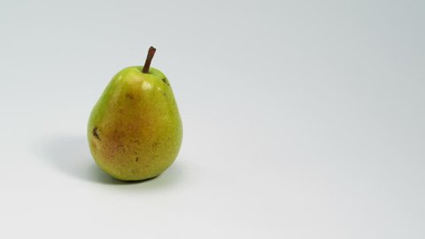 Multiple fruits appearing on white table with empty space for your message. 4K Stop motion food animation.