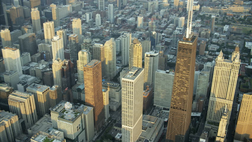 Aerial view at sunrise of Hancock Center Trump Tower Chicago Skyscraper buildings Financial District and skyline USA RED DRAGON | Shutterstock HD Video #23197936