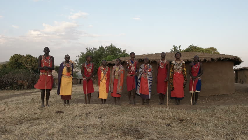 Wide view of a group of maasai women and men singing at a village in kenya  | Shutterstock HD Video #23220652
