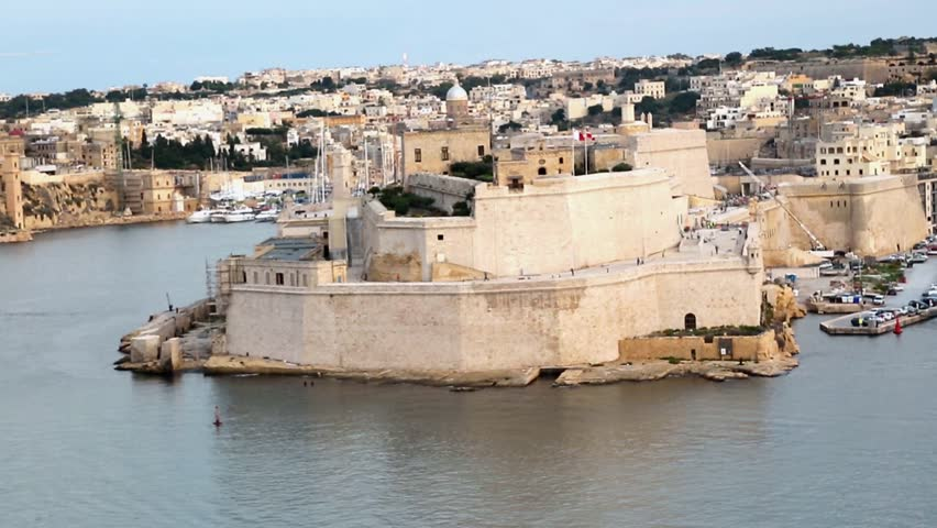 VALLETTA, MALTA - OCTOBER 30, 2015 : View of Malta island with Sant Angelo Fort and port with boats. St. Angelo Fort was built in 1505.
