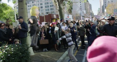 Women's March in Los Angeles, California. Over 500,000 people gathered in downtown Los Angeles. January 21, 2017. A young boy hitting a piñata that looks like Donald Trump.