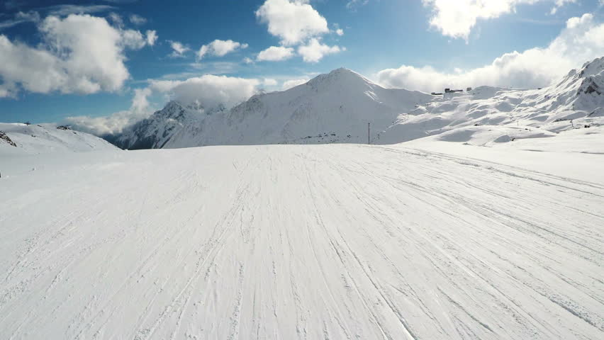 View Of Snowboarding On Snow Covered Landscape With Snowy Mountains 4K #23332012