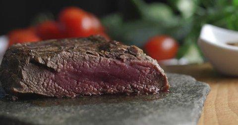 Tasty food, steak cut with knife on plate in luxury restaurant