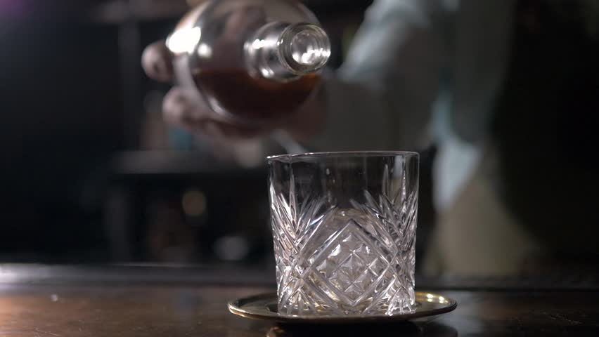 Bartender prepare Old fashion coctail in modern bar. Barmen stirring and pouring. #23367325
