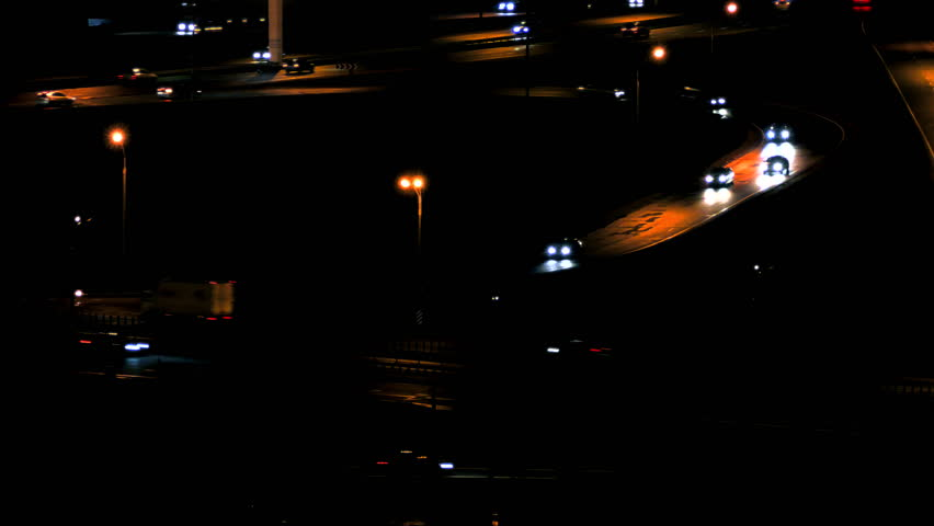 Cars on Road. Cars driving on a road junction in the night city. (av31573c)