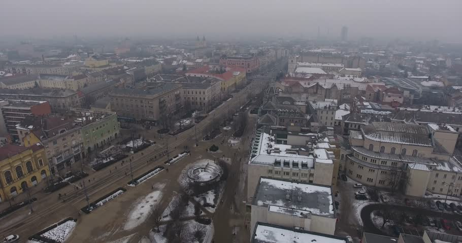 Aerial video shows the smog covered city of Debrecen in Hungary - 4K stock footage clip