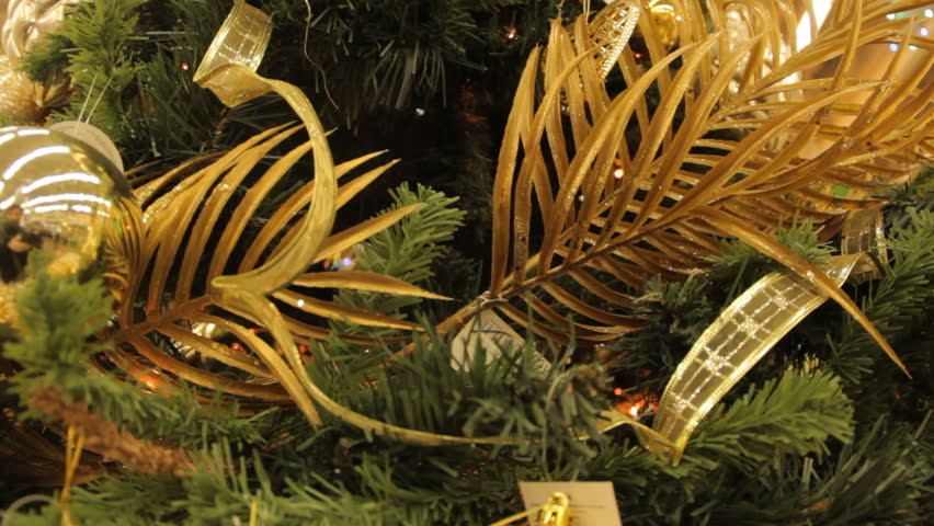 Christmas tree with yellow toys and decorations background. Close-up. In the hypermarket. #23435272