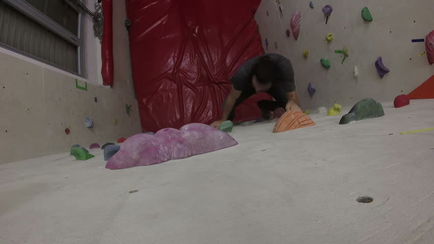 Young Man on Indoor Climbing Wall | Shutterstock HD Video #23444542