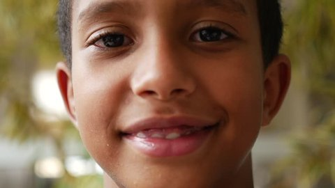 Brazilian kid smiling in slow motion