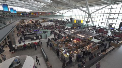 Crowd of people in the airport terminal departures hall - October 2016. Heathrow International Airport Terminal 5. London, England