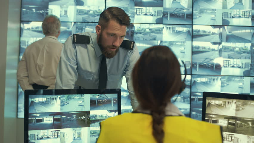 4K Security & surveillance team working in system control room | Shutterstock HD Video #23459296