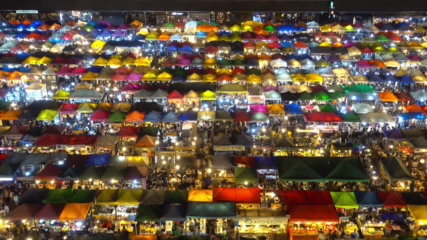 High view of colorful tent retail shop with night light at Talad Rod Fai Night Market, Ratchada, Bangkok, Thailand, timelapse 4k