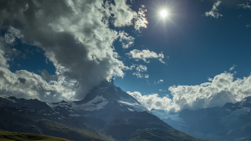 timelapse of the amazing matterhorn and surrounding mountains in the Swiss Alps with fantastic cloud formations