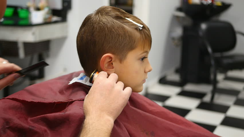 The Man Is Standing And Making Haircut For Small Boy Stock - Hairstyle boy hd images
