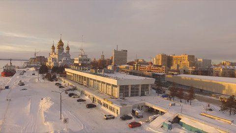Icebreaker at the pier, the great temple and the building of sea and river station. Russia, Arkhangelsk Oblast, the city of Arkhangelsk