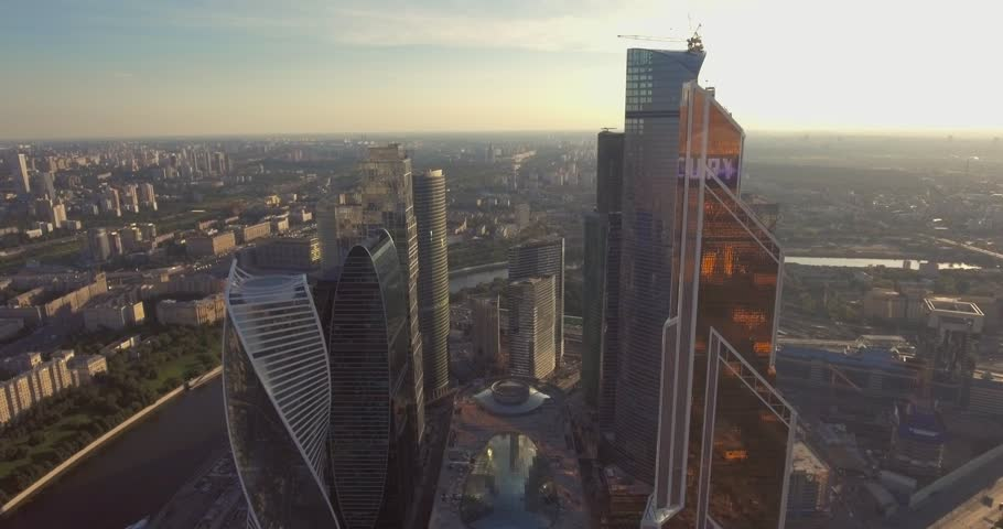 Business center Moscow City, aerial photography on the drone. Skyscrapers of glass and concrete in Moscow. Business center in the summer sun and surrounded by greenery. Kutuzovsky Prospect and Moscow | Shutterstock HD Video #23528572