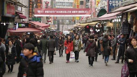 Seoul, South Korea - January 2017: People walking around the Namdaemun Market.