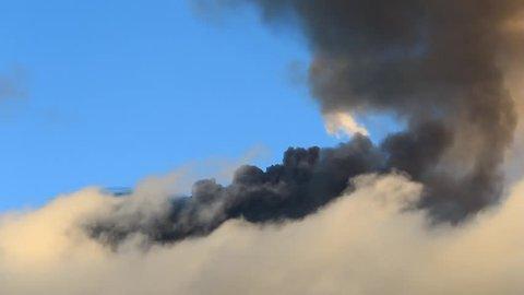 Tungurahua volcano in Ecuador, high presure gases and ash is blown into the sky.