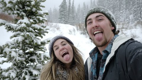 Fun Couple Take Fun Selfies (Use Camera Like It's A Smart Phone) They Smile/Kiss/Catch Snowflakes With Tongue