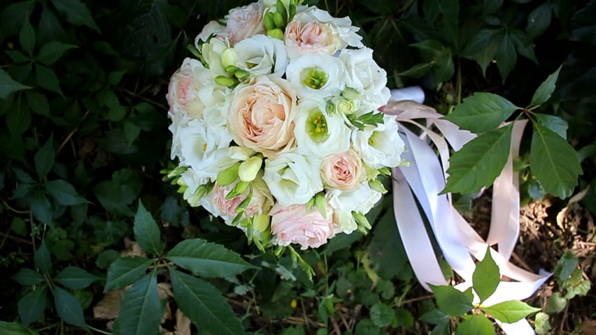 Bridal bouquet on grass with tape | Shutterstock HD Video #23566579