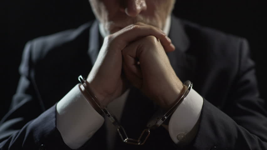 Punished oligarch handcuffed in prison, corrupt official accused of bribery