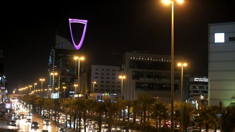 RIYADH, SAUDI ARABIA - JANUARY 25, 2017: Riyadh at Night with Cars during rush hour along King Fahad Highway with buildings such as Kingdom Tower shown in background