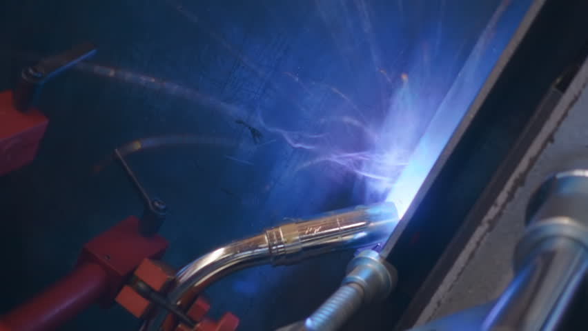 Automatic welding machine going welding of the metal profile. Sparks are flying in different directions. Slow motion, high speed camera, 250fps | Shutterstock HD Video #23613082