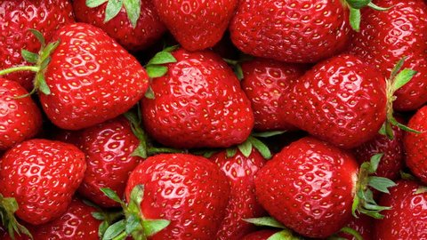 Strawberry background.  Red ripe organic strawberries on market counter. UHD, 4K