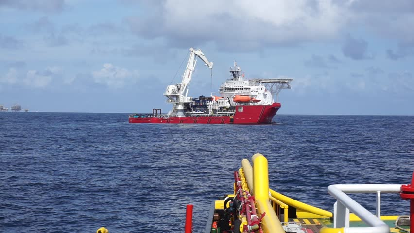 Offshore vessel recover pipe spool in the sub sea during gas pipeline installation project at Sarawak Operation, South China Sea,Malaysia.
