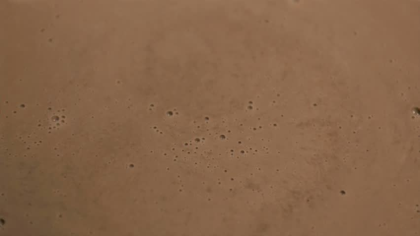 Close-up of milk chocolate in super slow motion falling