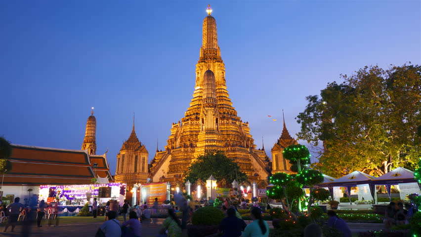 BANGKOK - APRIL 15: (Hyperlapse view) Many tourists near Wat Arun temple on April 15, 2012 in Bangkok, Thailand.