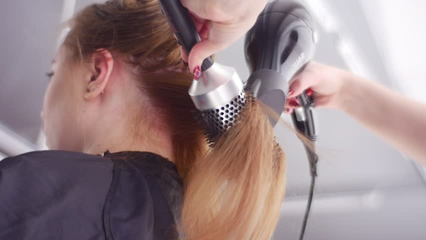 Back Hairs Drying, Stylist Using Round Brush, Slow Motion. the Hairs Are Separated Into Sections. Salon Hair Treatment by Well Qualified Hairdresser. Best Blow-Drying Technique. Hair-Saving Tips.