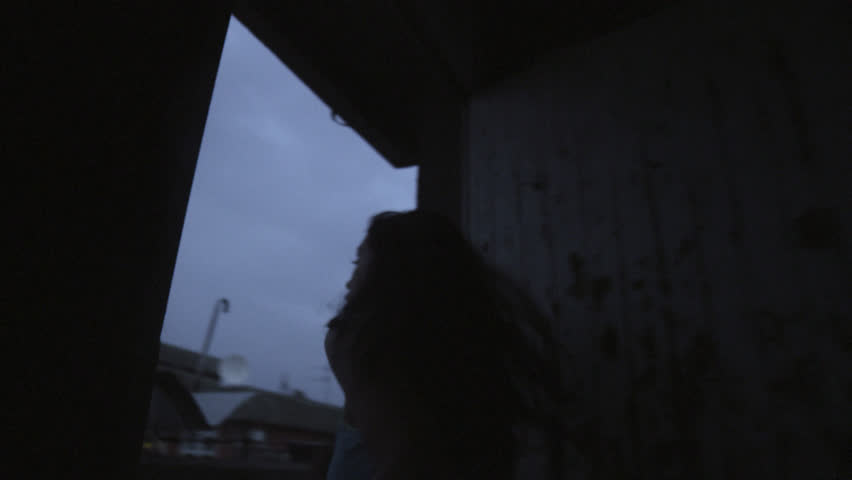Girl running on the rooftop in the dusk, jogging nike style ,  | Shutterstock HD Video #23706802