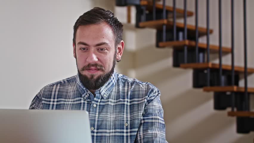 Close-up view of young man working at home on pc, win lottery, sukces shopping | Shutterstock HD Video #23716132