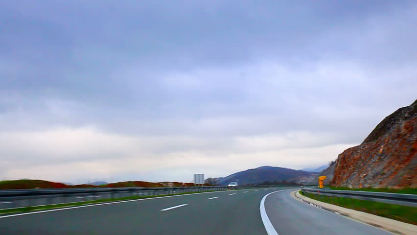 Car driving on highway before rain time lapse