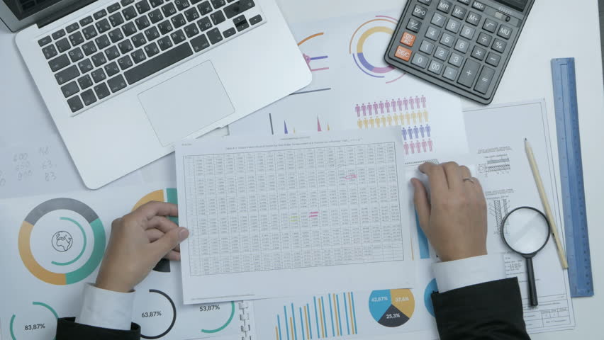 Financial specialist, businessman working with blueprint, graph at his workplace.   Shutterstock HD Video #23812099