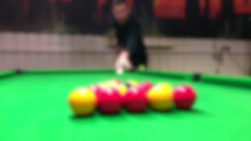Pool billiards game hall pub bar players cue 8 ball red yellow black green tables hit break start blurred abstract background | Shutterstock HD Video #23817022