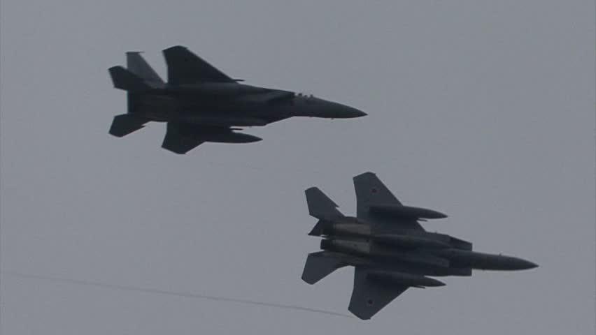 SHIZUOKA, JAPAN - MAY 20:  F-15 Eagle Afterburner pass and turn as part of the Japan Air Self Defense Force base airshow on May 20, 2012 in Shizuoka, Japan.