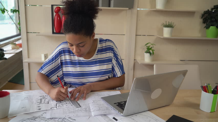 Professional engineer stick reminders on sketch blueprint stock mixed race worker in architectural agency working with sketch holding pencil and ruler young professional malvernweather Gallery