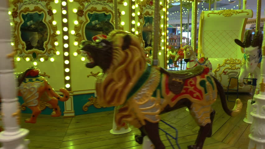 Carousel with beautifully painted wooden horses. 4K UHD | Shutterstock HD Video #23948152