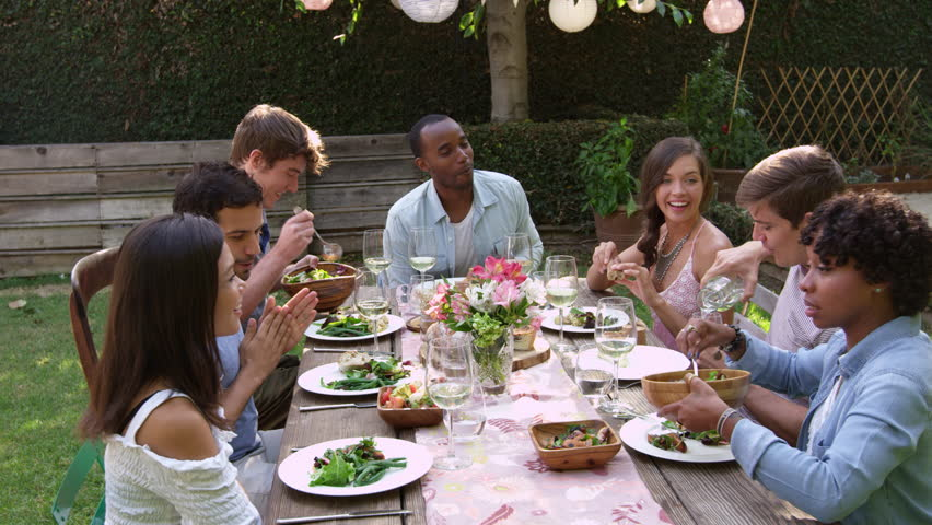 Friends Eat And Drink At Outdoor Party Table Shot On R3D