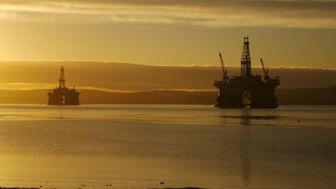 Silhouette of Semi Submersible Oil Rig and Big Boat at Cromarty Firth in Invergordon, Scotland