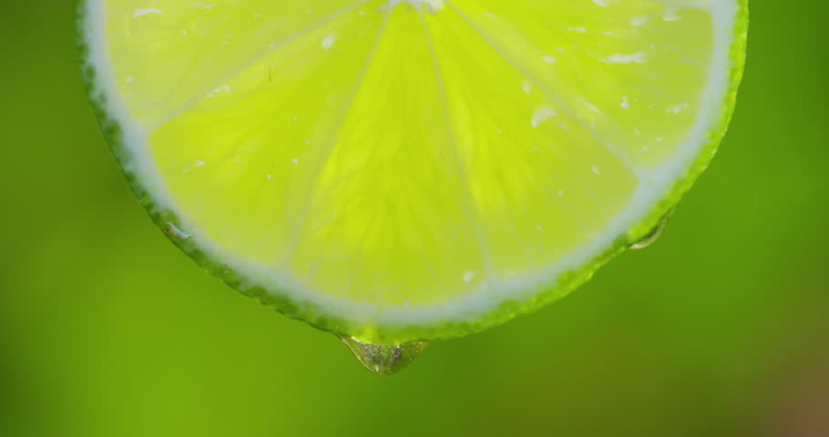 Cinemagraph - Close up or macro of a slice of orange, a drop of water falls in slow motion. The fruit gives off freshness and juice filling. Concept of fresh fruit, cocktail, orange juice and Italian