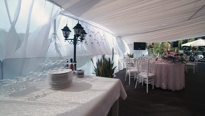 beautiful banquet hall under a tent for a wedding reception hd stock footage clip