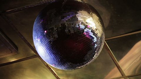 Party lights disco ball.Disco ball party in a nightclub.