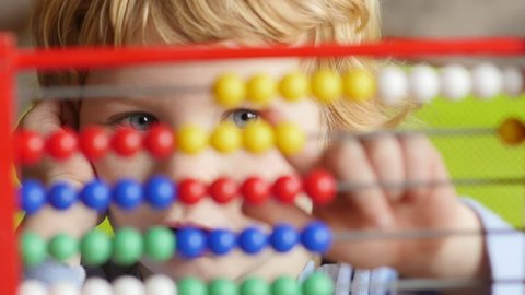 Caucasian Boy Learning Counting. Young caucasian boy early learning counting on abacus.