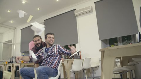 Young guys have fun in the office during a break