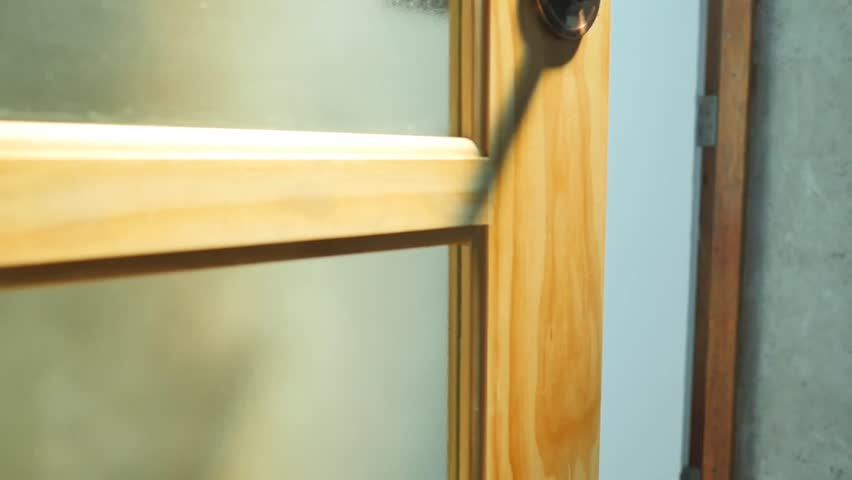 Plan camera from the bottom up focus on the wooden door.   Shutterstock HD Video #24088552